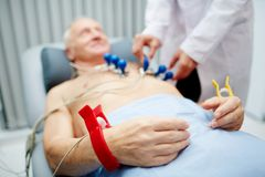 Having ecg. Hands of patient with special equipment around his wrists before having ecg stock photo