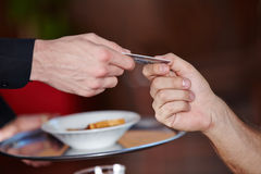 Hands paying with credit card Royalty Free Stock Image