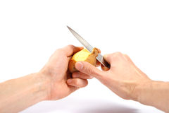 hands peel potato with knife Royalty Free Stock Photography