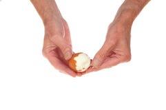 Hands peeling egg Stock Photo