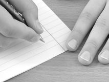 Hands with pen 1. Child hands with pen ready to write Royalty Free Stock Photography