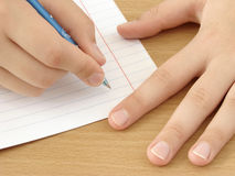 Hands with pen. Child hands with pen ready to write Royalty Free Stock Photography