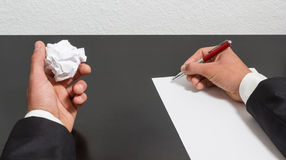 Hands with the pen and crumpled paper Royalty Free Stock Photos