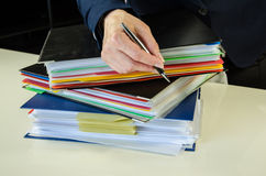 Hands with pen and files Stock Photo