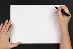 Hands, pen and paper Stock Images