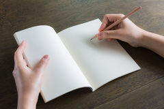 Hands with pencil and book Stock Photography