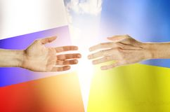 Hands people against the backdrop flags Russia and Ukraine royalty free stock images