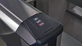 Hands of people apply electronic pass to turnstile wicket checkpoint in office. Modern equipment of access system in business center closeup. Macro video stock video