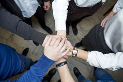 The hands of people are connected. A friendly team stock images