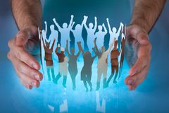 Hands with people cut out of paper Royalty Free Stock Images