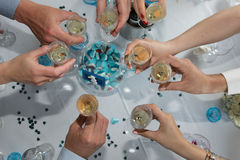 Hands of people drinking champagne on wedding day or celebration Stock Photo