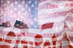 Hands of people holding the Flags of USA. Royalty Free Stock Photos