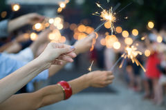 Hands of people holding sparklers at a wedding party Royalty Free Stock Image
