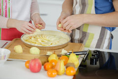 Hands people preparing apple tart Stock Photo