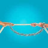 Hands of people pulling the rope on blue background. Competition concept Stock Photography
