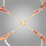 Hands of people pulling the rope on a gray background.  Competition concept Stock Images