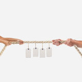 Hands of people pulling the rope on white background. Shopping concept Royalty Free Stock Images