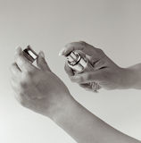 Hands with Perfume Bottle Stock Photo