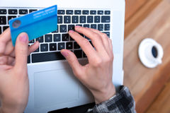Hands of person entering credit Card Data on Laptop Stock Images