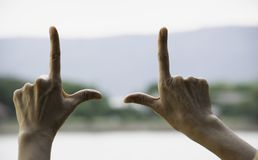 Hands of person making frame distance or symbol in nature.  stock photo