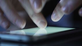 Hands of person typing message on smartphone touchscreen, using mobile app. Stock footage stock video