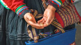 Close up of weaving and culture in Peru. Cusco, Peru: woman dressed in colorful traditional native Peruvian closing holding. Hands of peruvian woman holding stock photos