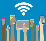 Hands with phones and tablets with wi fi Stock Images