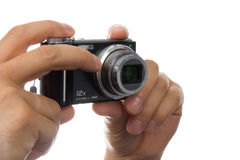 Hands with photo camera Royalty Free Stock Image