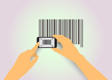Hands photographed barcode. Phone in the hands of the scanned bar code Royalty Free Stock Photo
