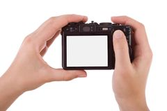 Hands photographic with a digital camera Royalty Free Stock Photography