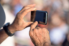 Hands photographing with cellular phone Royalty Free Stock Photography