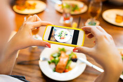 Hands photographing food by smartphone Royalty Free Stock Photos