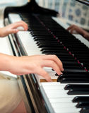 Hands of pianist performing on classical piano Royalty Free Stock Image