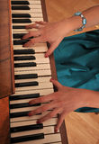 Hands of pianist Stock Images