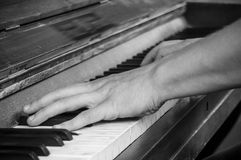 Hands of pianist on piano keys Stock Image