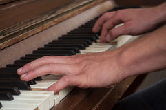 Hands of pianist on piano keys Stock Photography