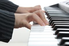 Hands of a pianist while playing Stock Image