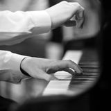Hands pianist Stock Images