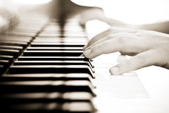 Hands on piano. Hands over piano in beautiful sepia tone Royalty Free Stock Photography