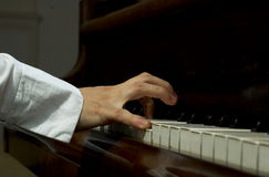 Hands on the Piano. Close view of the hands of an accomplished and prize winning pianist at the keyboard of a piano Royalty Free Stock Photo