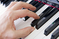 Hands on piano. Close-up of hands playing the piano royalty free stock photography