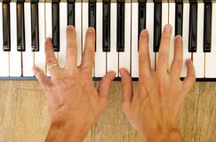 Hands and piano Royalty Free Stock Photos