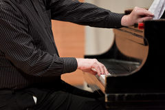 Hands of piano player. During performance Stock Photos