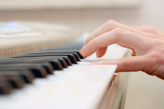 Hands and piano player Stock Images