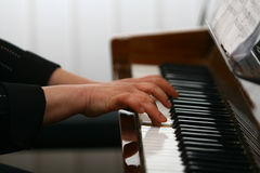 Hands of a piano player Stock Photos