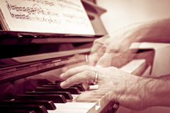 Hands at the piano Stock Images