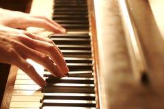 hands pianot Arkivfoto