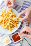 Hands Picking French Fries Stock Photography