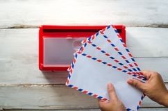 Hands are picking up the envelope in the mailbox. Hands are picking up the envelope in the mailbox Stock Image