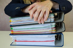 Hands on pile of folders Royalty Free Stock Images